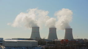 The thick pipe thermal power plant emits smoke stock footage