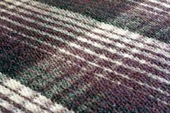 Thick plaid Mexican blanket. A warm, thick Mexican blanket made of cotton. Colors are shades of purple and off-white Royalty Free Stock Image