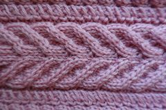 Thick pleat pattern on pink knitted fabric. From above Stock Image