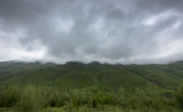 Thick Rain Clouds Over Green Mountains Royalty Free Stock Image