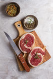 Thick raw beef roll with seasoning Royalty Free Stock Photo