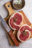 Thick raw beef roll with seasoning Royalty Free Stock Image