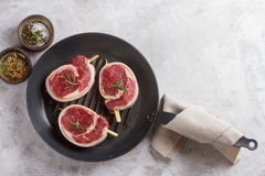 Thick raw beef with seasoning Stock Photo