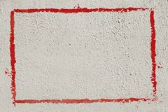 Thick red graffiti painted frame border on whitewashed concrete wall with copy space for writing - horizontal. Stock image stock illustration