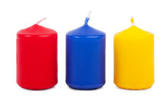 Thick red wax candle with a wick. On a white background Stock Image