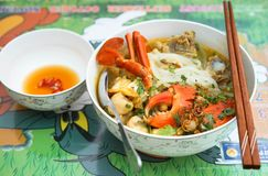 Thick rice noodle soup with crab, champinon and pork chop royalty free stock photos