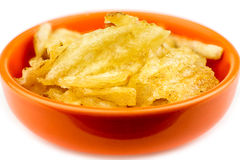 Thick rippled potato chips in bowl isolated Stock Images