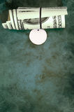 Thick roll of dollars Stock Photos
