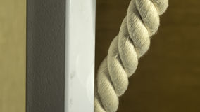 Thick rope and a metal pipe close-up Royalty Free Stock Photos