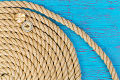 Thick rope and open directional compass Stock Images