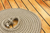 Thick rope on wood floor Stock Images