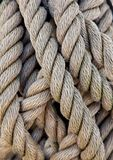 Thick ropes of a ship Taues. A thick ropes of a ship Taues Stock Photos