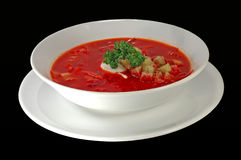 Thick Russian soup (borsh). Isolated over black background. White plate royalty free stock photos