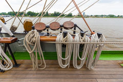 Thick ship vessel rigging rope in various shapes and colors on a boat Stock Images