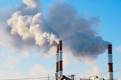 Thick smoke belching from factory chimneys Royalty Free Stock Images