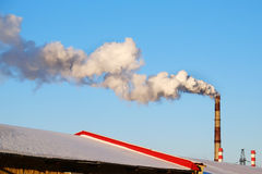 Thick smoke belching from factory chimneys Stock Photo