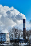 Thick smoke belching from factory chimneys Stock Images