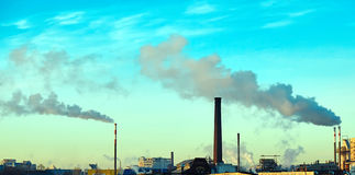 Thick smoke belching from factory chimneys Stock Photos
