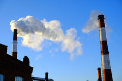 Thick smoke belching from factory chimneys Royalty Free Stock Photo