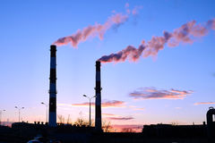 Thick smoke belching from factory chimneys Royalty Free Stock Photos