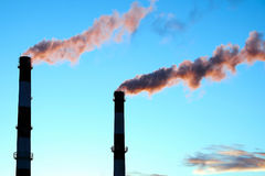 Thick smoke belching from factory chimneys. The thick smoke belching from factory chimneys Stock Image