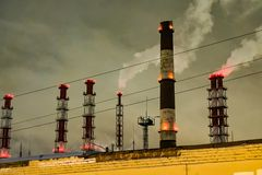 Thick smoke belching from factory chimneys. The thick smoke belching from factory chimneys Royalty Free Stock Images
