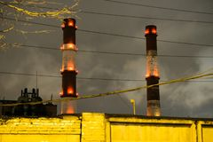 Thick smoke belching from factory chimneys. The thick smoke belching from factory chimneys Stock Photography