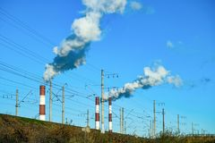 Thick smoke belching from factory chimneys. The thick smoke belching from factory chimneys Stock Images