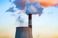 Thick smoke belching from factory chimneys. The thick smoke belching from factory chimneys Stock Photos