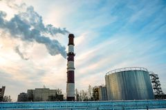 Thick smoke belching from factory chimneys. The thick smoke belching from factory chimneys Stock Photo