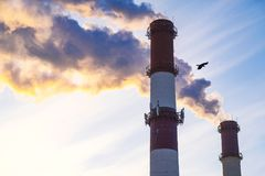 Thick smoke belching from factory chimneys. The thick smoke belching from factory chimneys Royalty Free Stock Photo