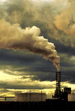 Thick smoke coming out of fact. Polluting thick smoke coming out of factory chimney Stock Image