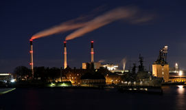 Thick smoke coming out of factory chimney. In the night Royalty Free Stock Photos