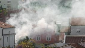Thick smoke engulfs a home BMPC4K stock video footage