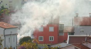 Thick smoke engulfs a home BMPC4K stock footage