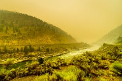 Thick Smoke in the Fraser Canyon in the Province of British Columbia, Canada. Thick Smoke in the Fraser Canyon from the 500 Forest Fires in the Province of stock images