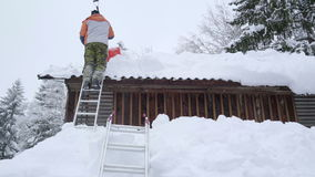 The thick snow covering the roof of a house stock footage
