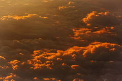 Thick soft clouds in slanting rays of setting sun. Thick soft clouds on idyllic sky, celestial sphere, in slanting rays of setting sun on yellow overcast Stock Photography