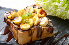Thick toast. A thick toast with banana and chocolate sauce on top royalty free stock photography