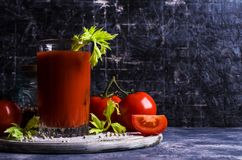 Thick tomato juice with celery. And spices in a glass on the table. Selective focus Stock Photo