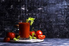 Thick tomato juice with celery. And spices in a glass on the table. Selective focus Stock Photos