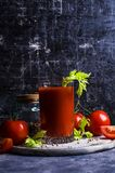 Thick tomato juice with celery. And spices in a glass on the table. Selective focus Stock Images