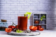 Thick tomato juice with celery. And spices in a glass on the table. Selective focus Royalty Free Stock Images
