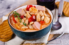 Thick vegetable soup. With beans and sausages. Selective focus stock photos