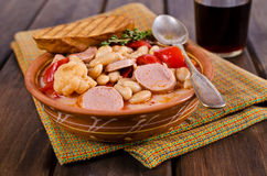 Thick vegetable soup. With beans and sausages. Selective focus stock photo