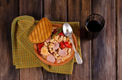Thick vegetable soup. With beans and sausages. Selective focus stock photography