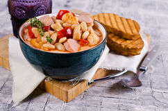 Thick vegetable soup. With beans and sausages. Selective focus stock image