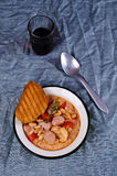 Thick vegetable soup. With beans and sausages. Selective focus royalty free stock images