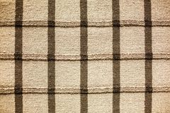 Thick weave striped rug on the floor stock images