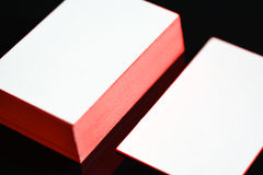 Thick white cotton paper business card mock up with red painted edges. Blank business cards template. Royalty Free Stock Photo
